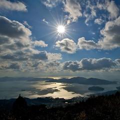 Winter sky and calm sea (shinichiro*) Tags: winter sea sky japan december hiroshima crazyshin 2010   nikond3 afsnikkor1424mmf28ged ds85188 gettyimagesjapan12q2