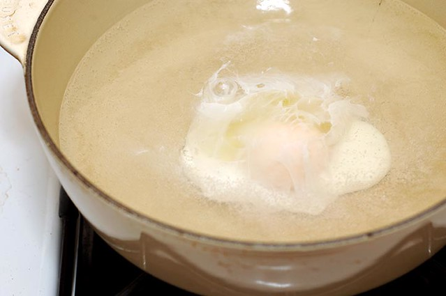 egg poaching in water