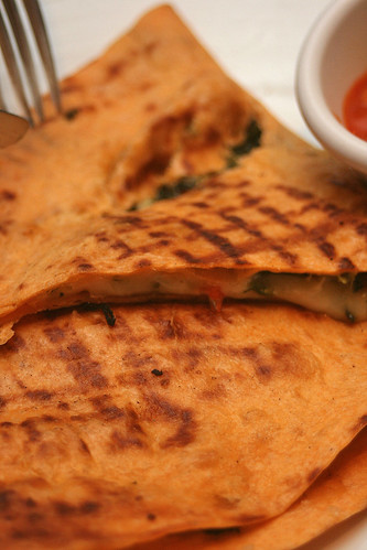 Grilled Mediterranean Quesadillas: Melted Monterey Jack cheese and vegetables sandwiched in warm tortilla; served with a tomato-cilantro salsa