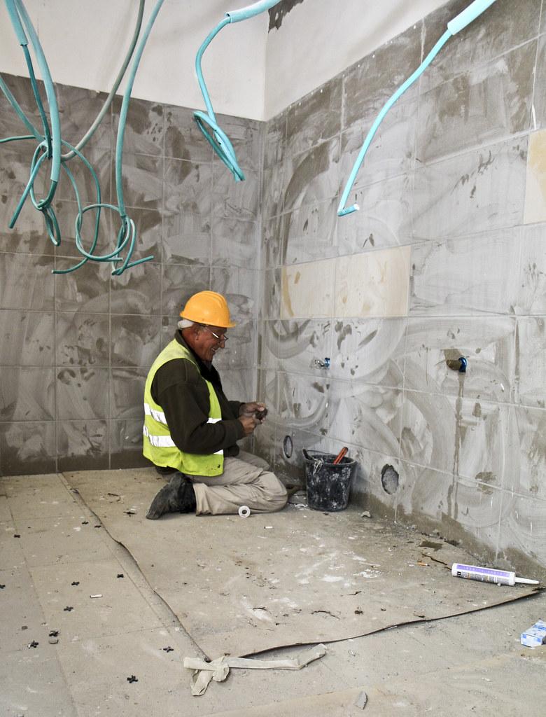 Contractor works on plumbing in Israel