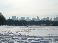 Central Park, New Year's Day 2011 (rosinberg) Tags: nyc snow newyork skyline melting centralpark manhattan snowstorm footprints snowball blizzard greatlawn newyearsday january2011
