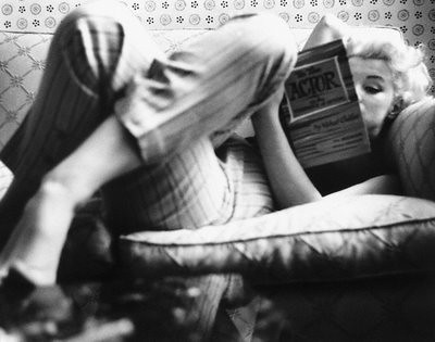 [_Marilyn_Monroe_at_the_Ambassador_Hotel_reading_a_book_on_acting_]_1955