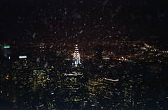 city snowstorm (scott w. h. young) Tags: nyc newyorkcity winter light snow storm love film night 35mm manhattan empirestatebuilding chryslerbuilding