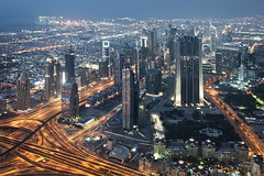 Dubai lights up (momentaryawe.com) Tags: buildings lights evening highway dubai skyscrapers dusk horizon uae middleeast aerial emirates bluehour sheikhzayedroad litup d300s catalinmarin momentaryawecom burjkhalifa
