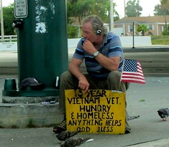 What does one do? (LarryJay99 ) Tags: man streets vet pigeon flag homeless vietnam hunger hungry patriot patriotism seated panhandler begger earphones streetpeople oldglory starsstripes vietnamvet