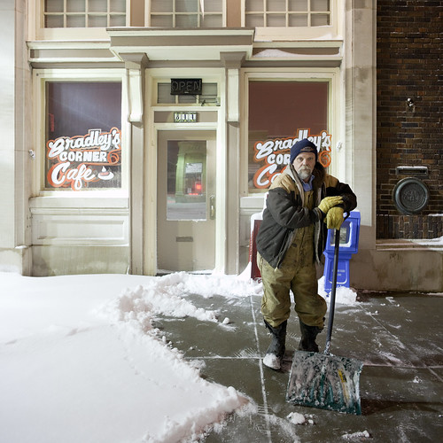 Shoveling Snow Outside Bradley's Corner Cafe