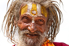 Holy Man (sandy_gennrich) Tags: world red india white man color yellow closeup religious day faces adult painted religion gray kind holy elderly elder weathered highkey udaipur gentle rajastan natgeo