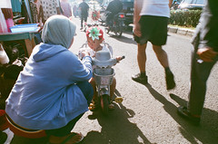 ... (firdaus usman) Tags: street morning indonesia pull golden glory hijab hour 200 feed nikonf makan pasar activities humaninterest momandson 2011 juanda depok minggu suap ibudananak fujiextra400 earthasia kaget sayanganak nikkor28mmf28ai jalanbaru