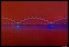 Riga: red, white and blue (Dan Wiklund) Tags: city longexposure bridge blue red urban white fog night cityscape latvia d200 2009 riga latvija daugava