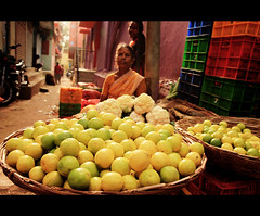 Lemon Lady!!! (VinothChandar) Tags: blue red portrait orange india color green yellow lady lemon market sale vibrant madras vendor chennai tamilnadu chengalpattu chengalpet