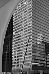 Giants, the Calatrava and 7 World Trade Center (sjnnyny) Tags: officebuilding 7worldtradecenter oculus calatrava nyarchitecture stevenj sjnnyny curtainwall constructionsite rebuilding bw monochrome sonya6000 emount55210f4563formirrorlessapsc parallellines grid lowermanhattan barclayveseybuilding height tall