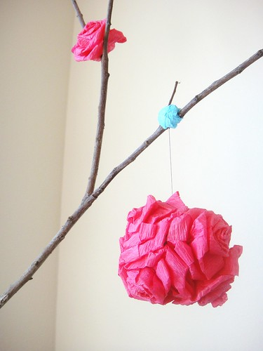 Crepe paper rose pomander on tree