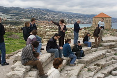 Students listen to the tour guide, Clare, as she speaks about the Byblos ruins.