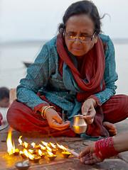 Dyas (Dick Verton) Tags: travel woman india lights asia varanasi ganges ghats diyas ritualights