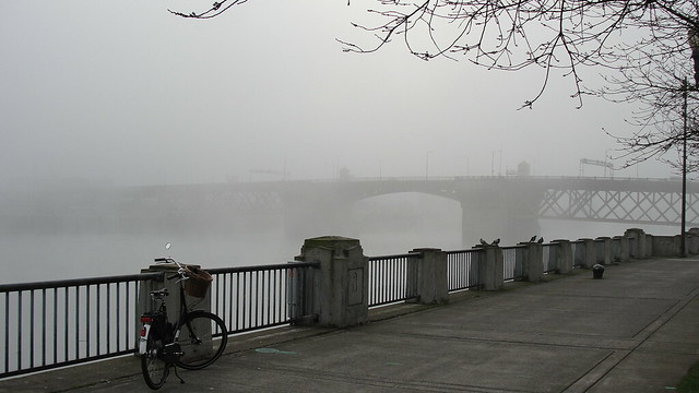 Portland's Burnside Bridge in the fog, from Waterfront Park, with a Dutch bicycle in the foreground