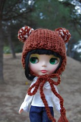Brown hat with pompoms