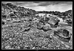 Tide (Emanuele Barcali) Tags: sea sky water rain zeiss t eos rocks mare tide cielo lowtide pioggia livorno coluds ze temporale marea 1835 distagon roccie approdo quercianella frangiflutti 1ds3 sogliera