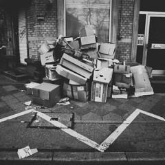 Trash (Martin Gommel) Tags: street blackandwhite bw streets 6x6 contrast trash germany ground sw schwarzweiss karlsruhe papier kontrast mll 1x1 quadrat quadratisch kartons