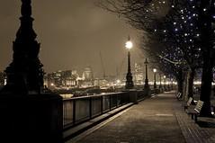 Along the Thames (SE16David) Tags: uk light london thames skyline sepia night river bench evening quiet riverside cathedral crane path walk stpauls rail walkway railing