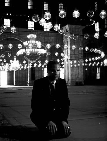 Malcolm X Praying in a Cairo Mosque