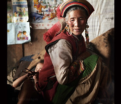 YI (BoazImages) Tags: poverty life china family boy woman home sad documentary indoors yunnan lolo minority yi hilltribe lolopo boazimages