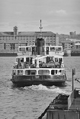 Ferry, 'cross the Mersey (Thirteensteps13) Tags: uk iris england bw film water ferry liverpool docks river boat nikon waterfront riverside harbour britain ships royal gb shipping ilford mersey waterway wirral merseyside scouse seacombe merseyferry royalirisofthemersey rnbmersey believeinfilm