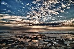 Nature's chaotic beauty (Bluemonkey08) Tags: sun water beauty clouds sunrise newcastle rocks chaos australia nsw sunrays hdr fader uwa ultrawideangle d90 nobbysbeach ericlam nikond90 perfectsunsetssunrisesandskys tokina1116mmf28atxpro bluemonkey08 faderfilters hdrefexpro nd4xhoyafilter