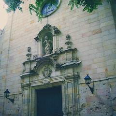 insight (boyletocho) Tags: barcelona door old building art history church statue wall architecture design spain ruins war arch bricks nouveau bullets felipe gunfire