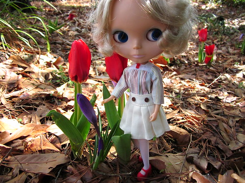 Noelle by the first flowers of the season.