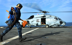 Sailor removes chocks from an MH-60S Sea Hawk helicopter. (Official U.S. Navy Imagery) Tags: navy helicopter sailor usnavy flightdeck seahawk guidedmissilefrigate gulfofaden mh60s usspearlharborlsd52 amphibiousship ctf151 combinedtaskforce151 counterpiracy usselrodffg55