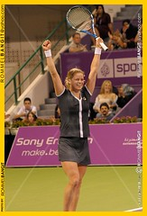Kim Clijsters of Belgium raises arms in triumphant joyful gesture during the Singles Finals against Caroline Wozniacki of Denmark during the WTA Championships at the Khalifa International Tennis and Squash Complex in Doha, Qatar on October 31, 2010 (ROMMEL BANGIT D318) Tags: vertical kim fulllength tennis winning kimclijsters qta wtaevent d318 rommelbangit kimantonielodeclijsters carolinewozniackiversuskimclijstersfinals qatartennisassociation sonyericssonwtachampionship2010