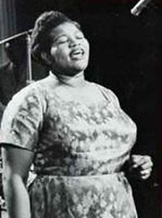 Big Mama Thornton singing, wearing a dress