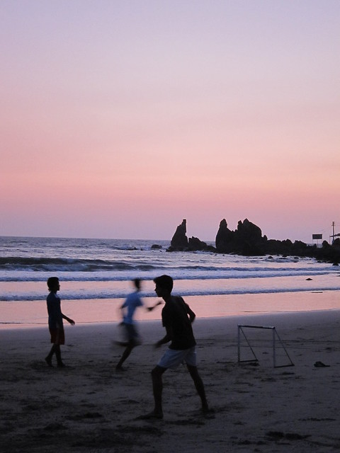 Beach football at sunset