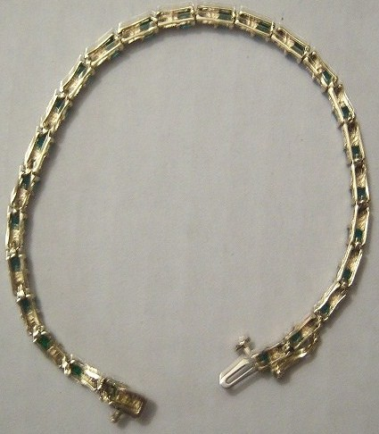 Gold Tennis Bracelet set with alternating table cut Emeralds and Diamonds (circa 1980's), reverse view