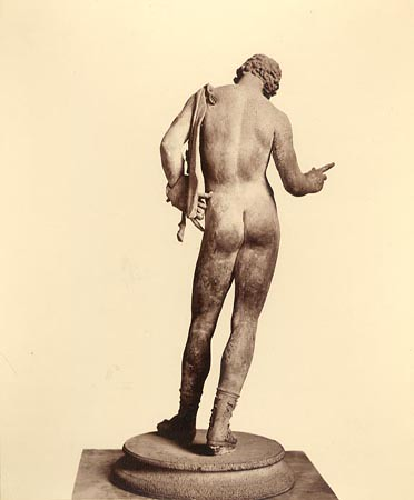 Bronze sculpture of Narcissus with a pelt tied around his shoulder from Vicolo del Balcon Pensile in Pompeii. Photo by Giorgio Sommer c. 1880. Penn Museum Object #1535. Penn Museum Image #166331.