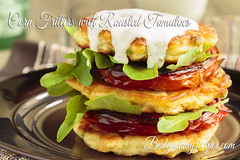 Corn Fritters with Roasted Tomatoes (Thinkarete) Tags: ranch red food color green glass vegetables yellow horizontal dinner tomato lunch cuisine daylight healthy corn colorful dish image sauce plate naturallight nobody stack meat lettuce snack meal vegetarian pancake ranchdressing roasted arugula fritter