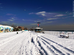 Coney Island in Winter. (The diary of Blue Shoes!) Tags: ocean city nyc sunset sky people usa sun snow newyork nature water birds america coneyisland fire photography pier amazing community shadows dusk manhattan amusementpark states russians    littlerussia   littleodessa