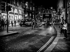 Crossing (michael.knight65) Tags: blackandwhite streetphotography photooftheday digital outdoor people mono monochrome city town street black white man woman young old olympus omdem5ii phone mobile legs bus london portrait character urban scene european contrast expressive photography candid streetportraiture england travel travelling couple smartphone faces face realpeople reallife cycle taxi night