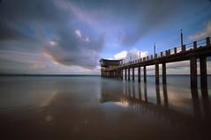 Moyo's Pier (Nirun Dowlath) Tags: longexposure bw seascape clouds reflections point southafrica pier nikon shoreline wideangle durban ushaka d90 sigma1020 moyos nd110 nirundowlath moyospier