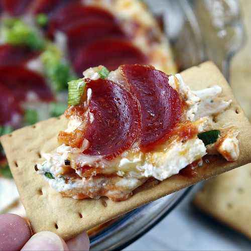 Pepperoni Pizza Dip - individual serving on a cracker
