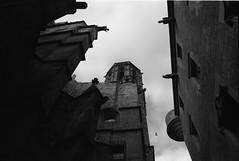 Gothic Barcelona (gargoyles and a flying pigeon) (Jordi Aragon) Tags: barcelona street blackandwhite bw film 35mm gothic catalonia gargoyle blancinegre canoneos300 kodaktmax canonef28135is epsonv700 bwneutraldensityfilter1012x
