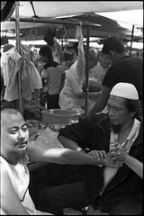 People Of Pudu Market (+pelican+) Tags: 35mmfilm rm nikonfe2 kodaktrix400 autaut negativescanned pudumarket carlzeissplanar50mmf14zf malaysianpeople pudumarketstreetshot 35mmfilmphotographer thanxsuhaimisallehforthescan singlelensreflectcamera