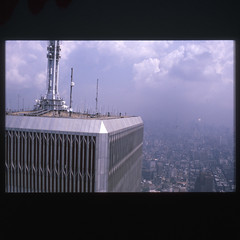 056:365 | WTC (1995) | From the shoe box (7/7) (Pascal Lagarde) Tags: nyc newyorkcity blue roof sky tower project view worldtradecenter memories slide scan theme week twintowers wtc 365 pictureoftheday antenna onepictureperday project365 week08 day056 fromtheshoebox 056365 2011inphotos 25022011