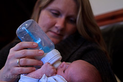 A mothers love (s0ulsurfing) Tags: pink blue woman baby blur cute modern bottle eyes hands infant babies dof faces feeding drink mother drinking william plastic mum help newborn formula feed infants bottlefeeding 2011 s0ulsurfing familyuk