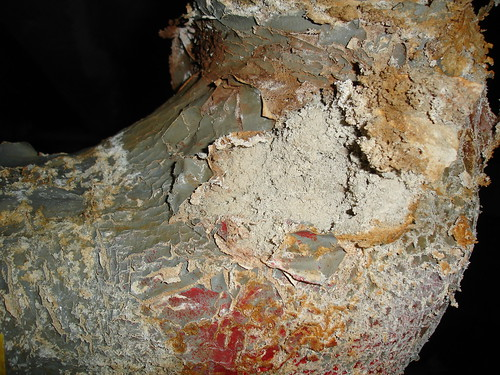 Damaged Asbestos Insulation on Pipe Elbow - a photo on