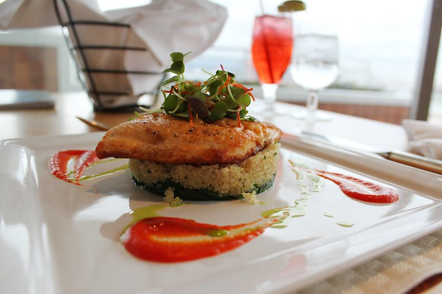 Pan Seared Arctic Char wilted baby spinach, yuzu infused quinoa & red pepper coulis