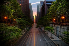 Manhattanhenge, New York City (mudpig) Tags: nyc sunset ny newyork skyline geotagged cityscape manhattan gothamist chryslerbuilding eastside hdr manhattanhenge 42ndstreet tudorcity mudpig stevekelley