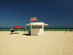 South Beach Miami (al-absi) Tags: blue sea usa beach america umbrella us sand florida miami flag south tan olympus shack        1442mm   e620