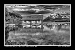 Boathouse at Maligne Lake, Jasper National Park, Alberta (kgogrady) Tags: park wood trees summer blackandwhite bw mountain lake canada mountains west reflection building tree water rock clouds landscape rockies evening blackwhite wooden nikon jasper rocky noone peak ab nopeople canadian national canoes alberta western rockymountains peaks maligne jaspernationalpark malignelake d300