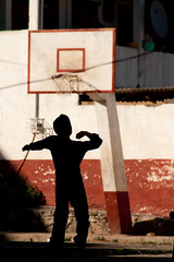 kid imagination (notarim) Tags: red latinamerica silhouette basketball vertical mexico kid morelia outdoor fulllength highcontrast creativecommons imagination chiaroscuro 32 oneperson janitzio clairobscur colorimage 110504 lagodepatzcuaro byncnd kidimagination notarim